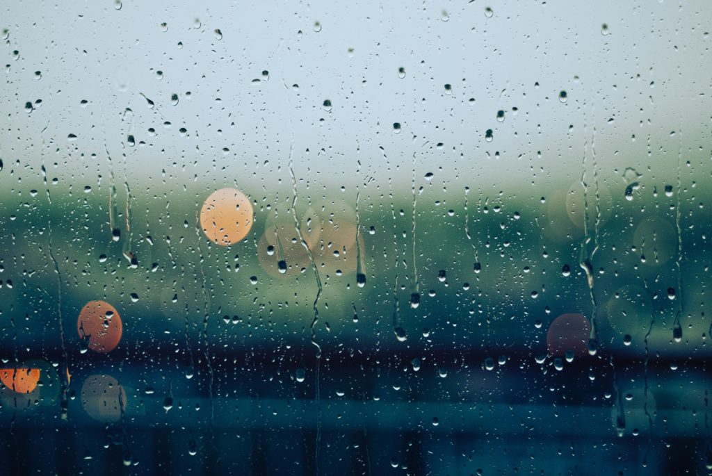 Rain pouring down a window
