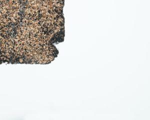 Piece of asphalt shingle