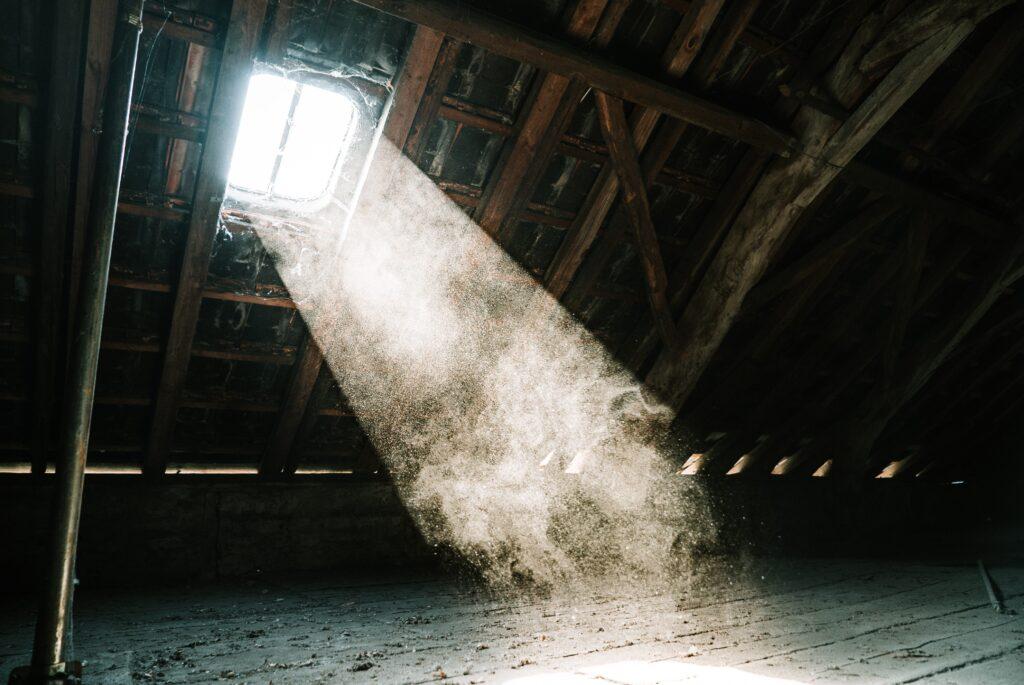 Light shining through a skylight into an attic.